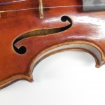 Workshop in advanced violin repair. Retouching of varnish.