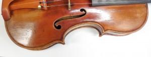 Workshop in advanced violin repair. Retouching of varnish.